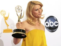 Claire Danes raises the Emmy award for outstanding lead actress in a drama series for her role in 'Homeland' at the 64th Primetime Emmy Awards in Los Angeles
