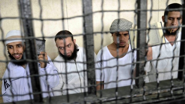 Militant Islamists react as they attend their verdict at a court in Ismailia city