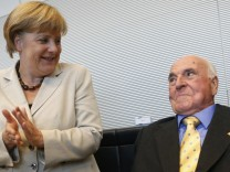 German Chancellor Merkel applauds as former German chancellor Kohl arrives for CDU and CSU party faction meeting in Berlin