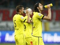 Kehl, Piszczek and Subotic of Borussia Dortmund walk off the pitch after their German first division Bundesliga soccer match against Eintracht Frankfurt in Frankfurt