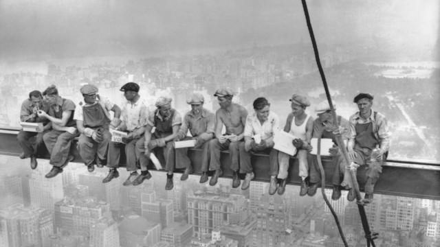 Construction workers eat their lunch atop the RCA Building in New York