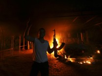 File photo shows a protester reacting as the U.S. Consulate in Benghazi is seen in flames