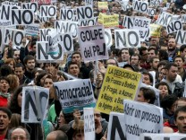 PEOPLE GATHER TO PROTEST AT THE LOWER HOUSE OF THE SPANISH PARLIA