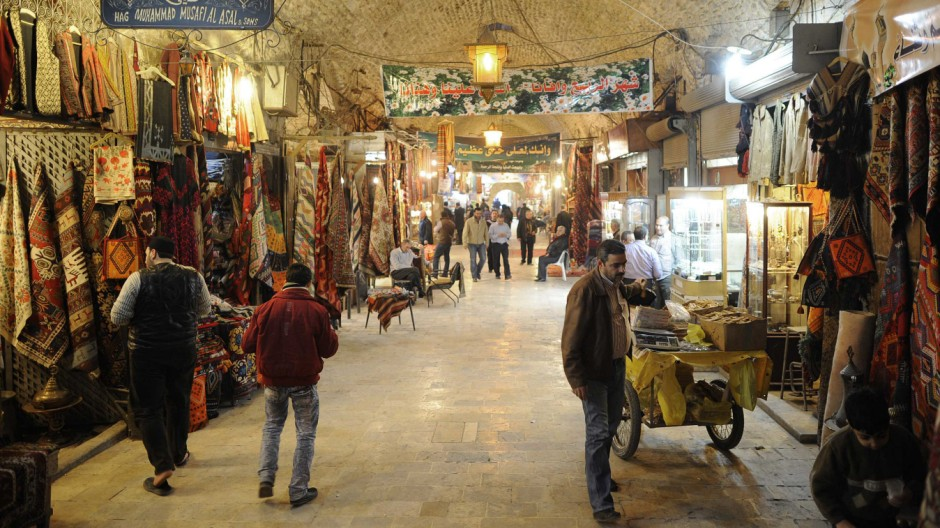 File photo of people walking through Al-Madina Souq market in Aleppo