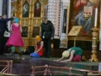 Still image taken from file video shows members of the female punk band 'Pussy Riot' staging a protest inside Christ The Saviour Cathedral in Moscow