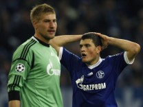 Schalke 04's Lars Unnerstall and Kyriakos Papadopoulos react during the Champions League soccer match against Montpellier HSC in Gelsenkirchen