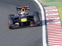 Red Bull Formula One driver Sebastian Vettel of Germany drives during the Japanese F1 Grand Prix at the Suzuka circuit