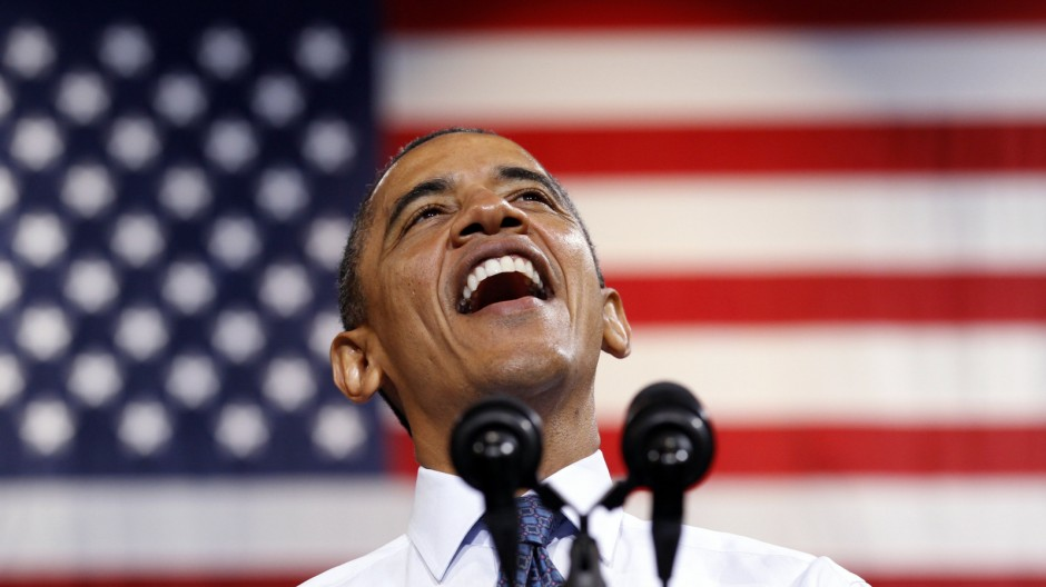 U.S. President Obama smiles as he speaks during a campaign rally in Fairfax, Virginia