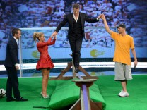 German TV show host Lanz balances on a rubber band during the German game show 'Wetten Dass' (Bet it...?) in the western German town of Duesseldorf