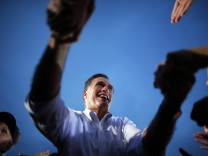 Republican presidential nominee Romney greets audience members at a campaign rally in St. Petersburg