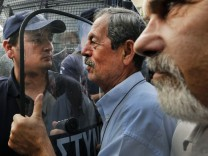 Pensioner pushes riot policeman during demo in Athens