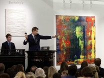 Handout photo of an auctioneer directing bidding for the sale of Gerhard Richter's Abstraktes Bild (809-4), from the collection of musician Eric Clapton