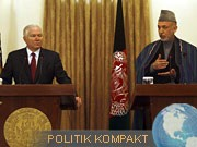 Robert Gates, Hamid Karsai, AFP