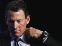 File photograph of Lance Armstrong taking part in a special session regarding cancer in the developing world during the Clinton Global Initiative in New York
