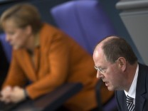 SPD's Steinbrueck replies to German Chancellor Merkel's  government policy statement  during Bundestag session in Berlin
