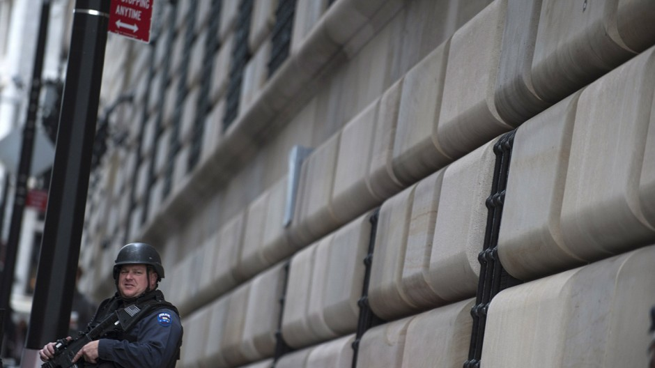 A New York City Police officer stands guard in front of the New York Federal Building in New York
