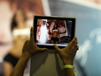 Visitor takes a picture of a porn actress with his Ipad during the Sex and Entertainment 2012 adult exhibition at the Palacio de los Deportes in Mexico City
