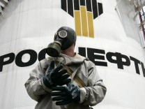 A member of the Emergencies Ministry takes part in an exercise in front of a storage facility which belongs to oil producer Rosneft, outside Russia's southern city of Stavropol