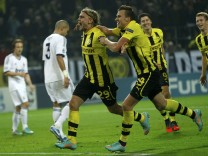 Borussia Dortmund's Schmelzer celebrates with his team mates Grosskreutz and Lewandowski after scoring a goal against Real Madrid during their Champions League Group D soccer match at BVB stadium in Dortmund
