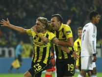 Borussia Dortmund's Schmelzer celebrates with his team mate Grosskreutz after scoring a goal against Real Madrid during their Champions League Group D soccer match at BVB stadium in Dortmund