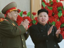 File photo of North Korean leader Kim Jong-Un and chief of general staff of the Korean People's Army Ri Yong-ho during a military parade in Pyongyang