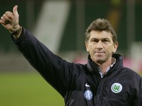 Wolfsburg's coach Augenthaler celebrates after their German Soccer Cup quarterfinal match against Alemannia Aachen in Wolfsburg
