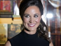 Pippa Middleton, sister of Catherine, Duchess of Cambridge, poses for photographers to promote her first book 'Celebrate', on party planning, in London