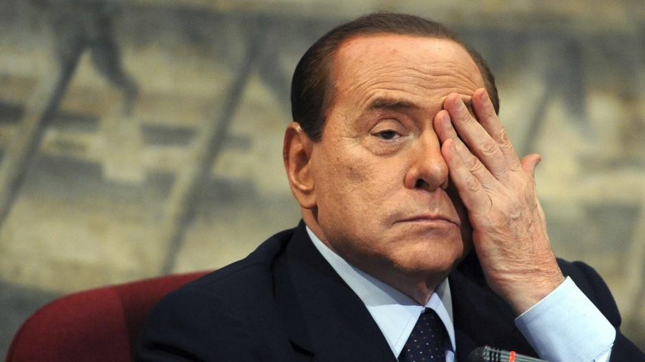 File photo of Italian PM Berlusconi gestures during a presentation of a book by Italian member of Parliament Scilipoti in Rome