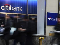 File photo of people walking by a Citibank branch in New York