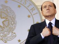File photo of then Italian Prime Minister Berlusconi leading a news conference at Villa Madama in Rome