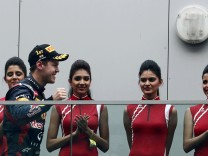 Red Bull Formula One driver Vettel walks towards the podium past grid lines after winning the Indian F1 Grand Prix at the Buddh International Circuit in Greater Noida