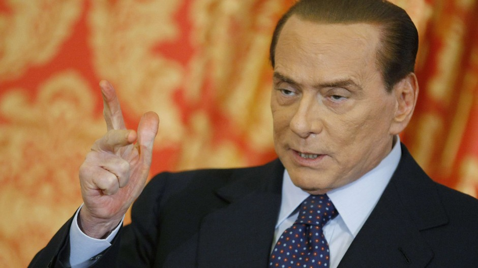 Italy's former Prime Minister Silvio Berlusconi gestures as he speaks during a news conference at Villa Gernetto in Gerno