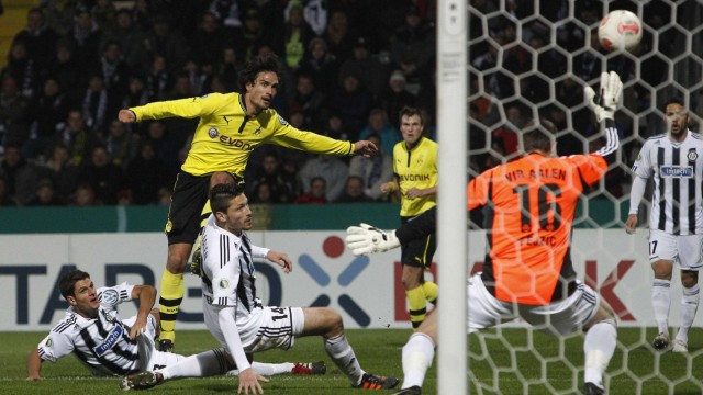 Borussia Dortmund's Hummels scores past VfR Aalen's Kister and VfR Aalen's goalkeeper Fejzic during their German DFB Cup second round soccer match in Aalen