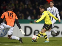 Borussia Dortmund's Goetze scores past VfR Aalen's Fejzic during their German DFB Cup second round soccer match in Aalen