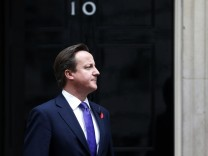 Britain's Prime Minister Cameron stands outside Number 10 Downing Street in London