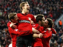 Bayer Leverkusen's players celebrate a goal against Fortuna Duesseldorf during the German first division Bundesliga soccer match in Leverkusen