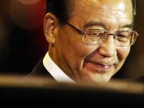 China's Premier Wen Jiabao arrives at Vientiane airport