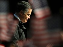 Republican presidential nominee Mitt Romney pauses while speaking at a campaign rally in Newport News