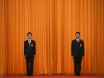 Beamte bewachen den Parteitag der Kommunistischen Partei Chinas