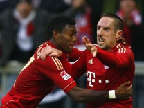 Ribery of Bayern Munich celebrates with team mate Alaba after scoring  against Eintracht Frankfurt during Bundesliga soccer match in Munich