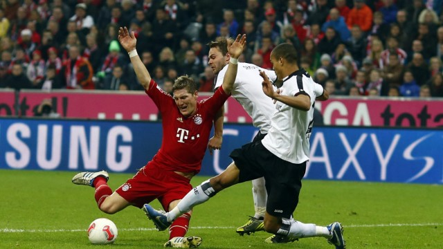 Munich's Schweinsteiger is fouled to receive a penalty during their German Bundesliga first division soccer match in Munich