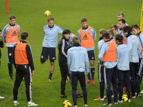 Germany's coach Low speaks to team members during a training session in Amsterdam Arena stadium