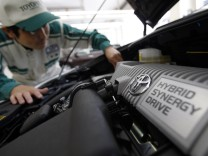 An engineer of Nagoya Toyopet, a Toyota Motor Corp dealership, does a check up on a recalled Prius hybrid in Nagoya, central Japan