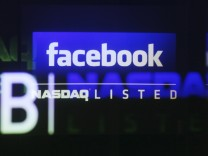 File photo of Facebook logo seen on a screen inside at the Nasdaq Marketsite in New York