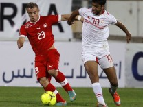 Tunisia's Oussama Darragi fights for the ball with Switzerland's Shaqiri Xherdan during their international friendly soccer match in Sousse