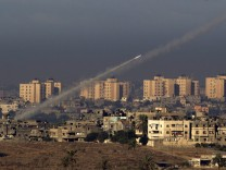 A rocket soars above the city towards Gaza