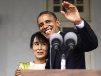 U.S. President Obama hugs Suu Kyi at end of their remarks to the media at her residence in Yangon
