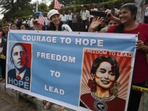 Crowds line a street outside the home of Myanmar's opposition leader Aung San Suu Kyi as U.S. President Barack Obama arrives to meet her in Yangon