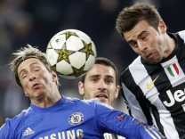 Chelsea's Fernando Torres jumps for the ball with Juventus' Andrea Barzaglio during their Champions League soccer match at the Juventus stadium in Turin