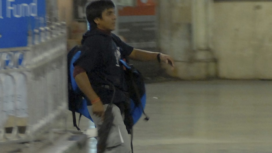 File photo of Mohammad Ajmal Kasab, a then suspected gunman, walking in the premises of the Chhatrapati Shivaji Terminus or Victoria Terminus railway station in Mumbai